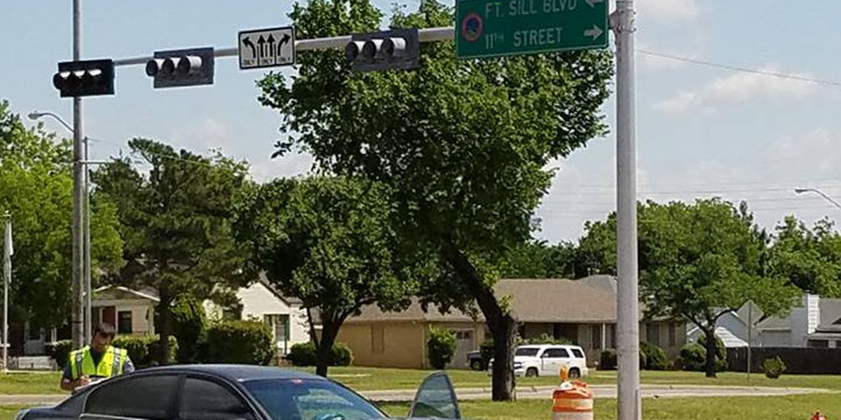 Car runs red light and hits police cruiser and bicyclist in Lawton