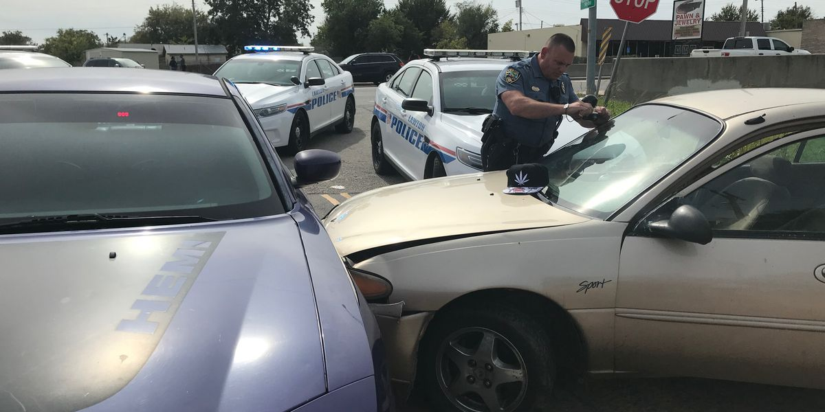 Officer's vehicle struck by car during Lawton pursuit