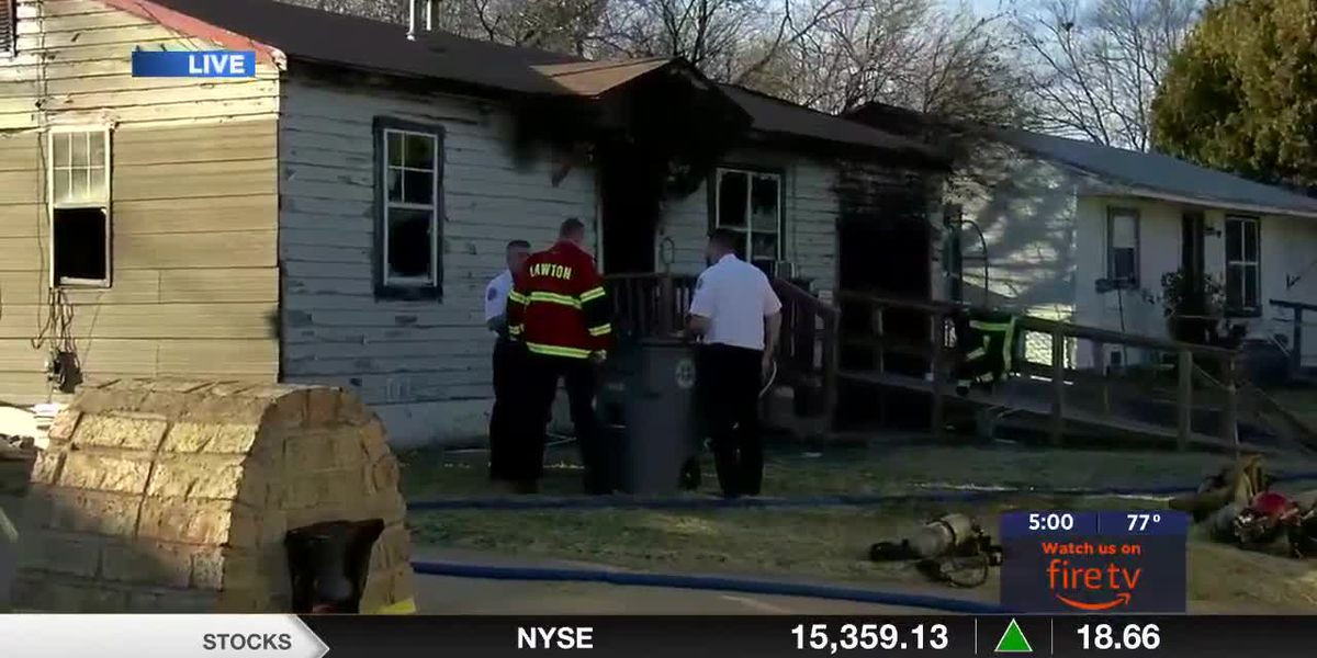 Firefighters pull victim from burning Lawton home