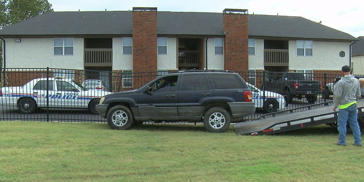 Driver arrested after crashing vehicle into apartment fence