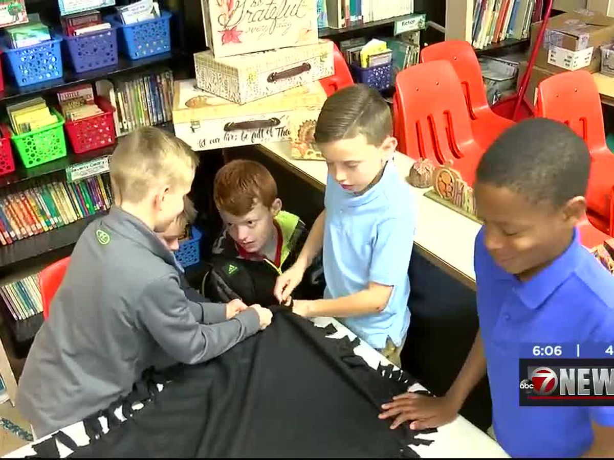 Students at Sullivan Village make blankets for veterans
