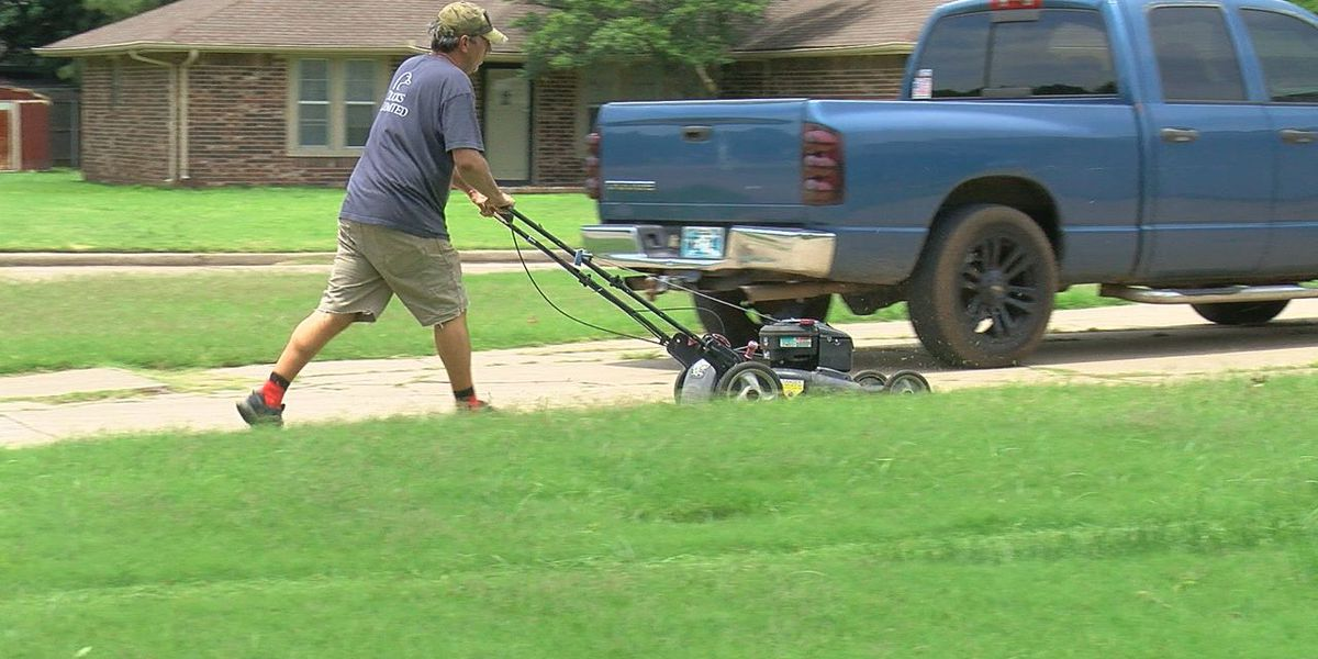 Duncan men mowing lawns for those in need