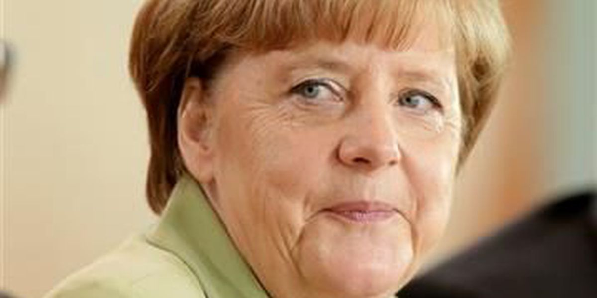 Crying refugee girl puts German chancellor on the spot
