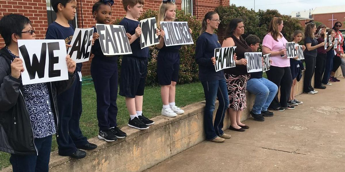 Parents protest, priest removed