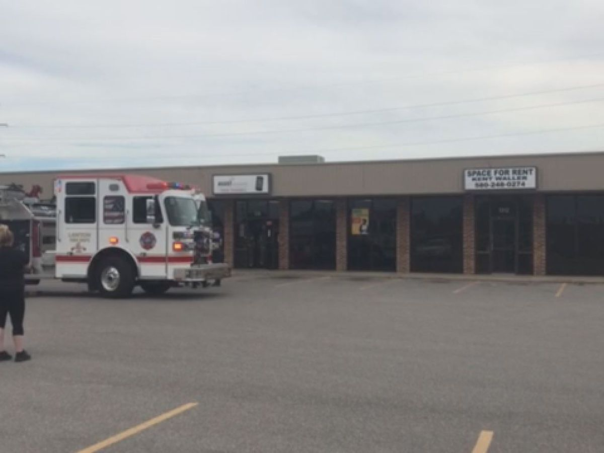 Firefighters respond to fire in business lighting system