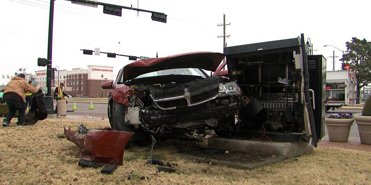 Car accident damages stoplight