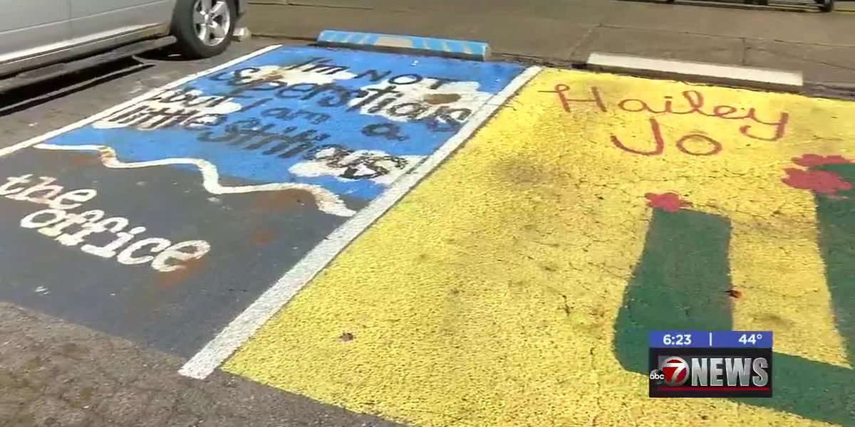 Walters High students paint parking spaces for beautification project