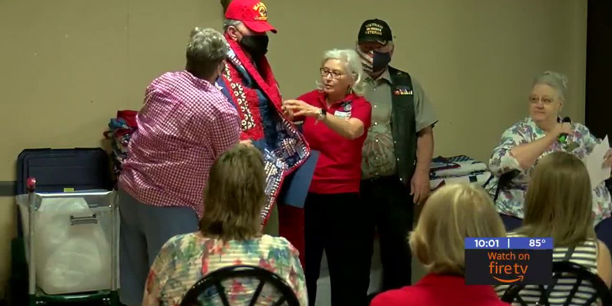 Homemade quilts presented to combat veterans