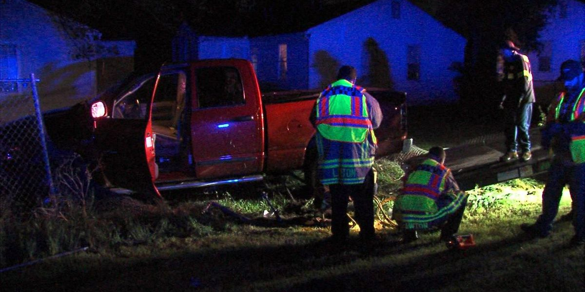 Pickup crashes into stop sign, two gas meters