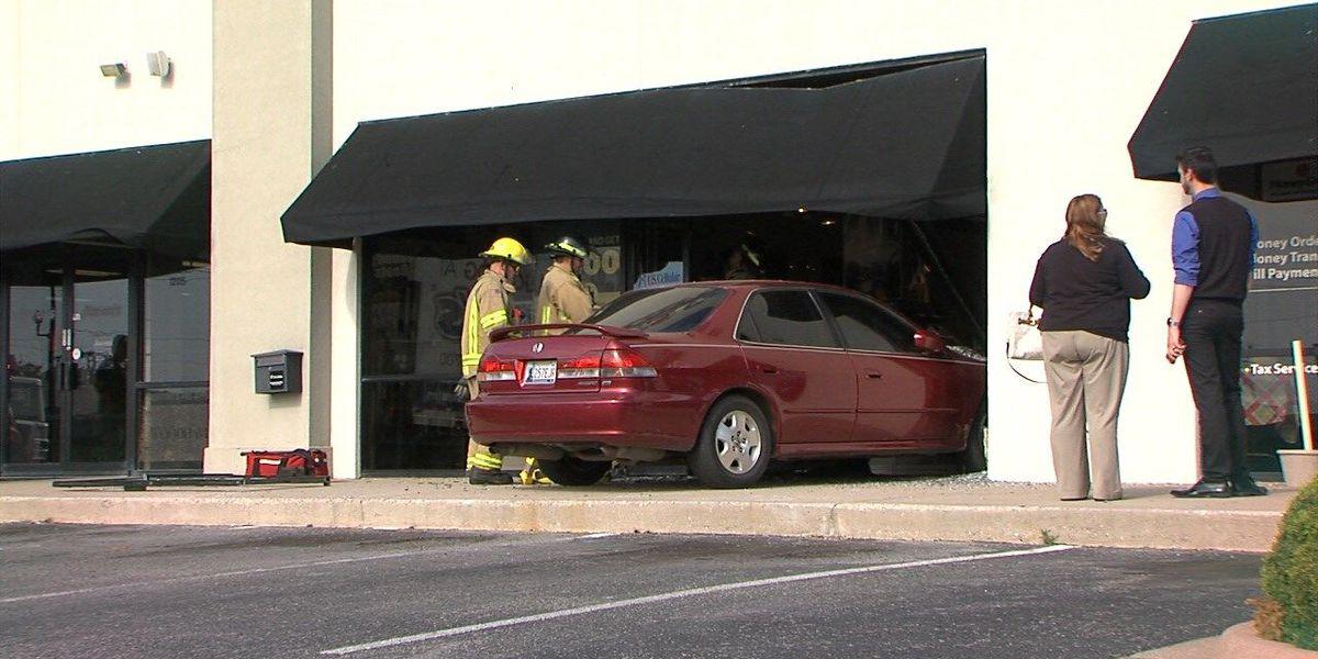 Car crashes through U.S. Cellular store front