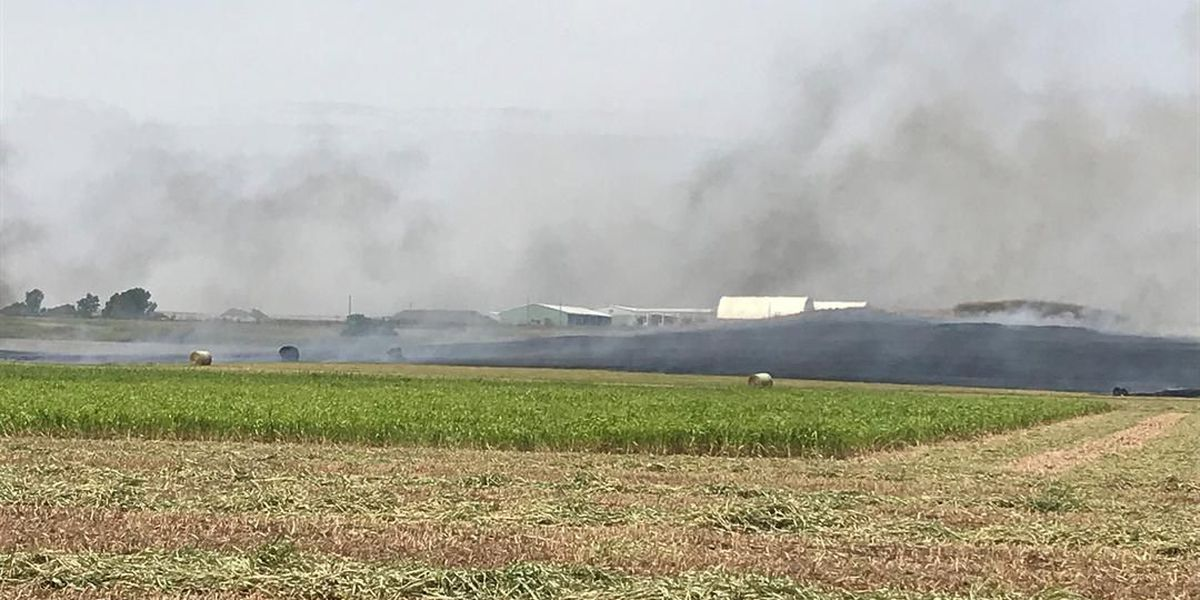 Grass fire north of Walters sparked by hay baler
