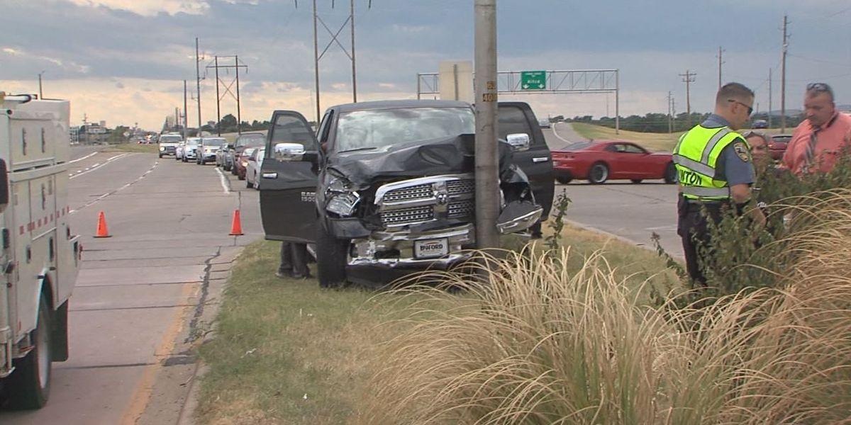 Pickup crashes into light pole