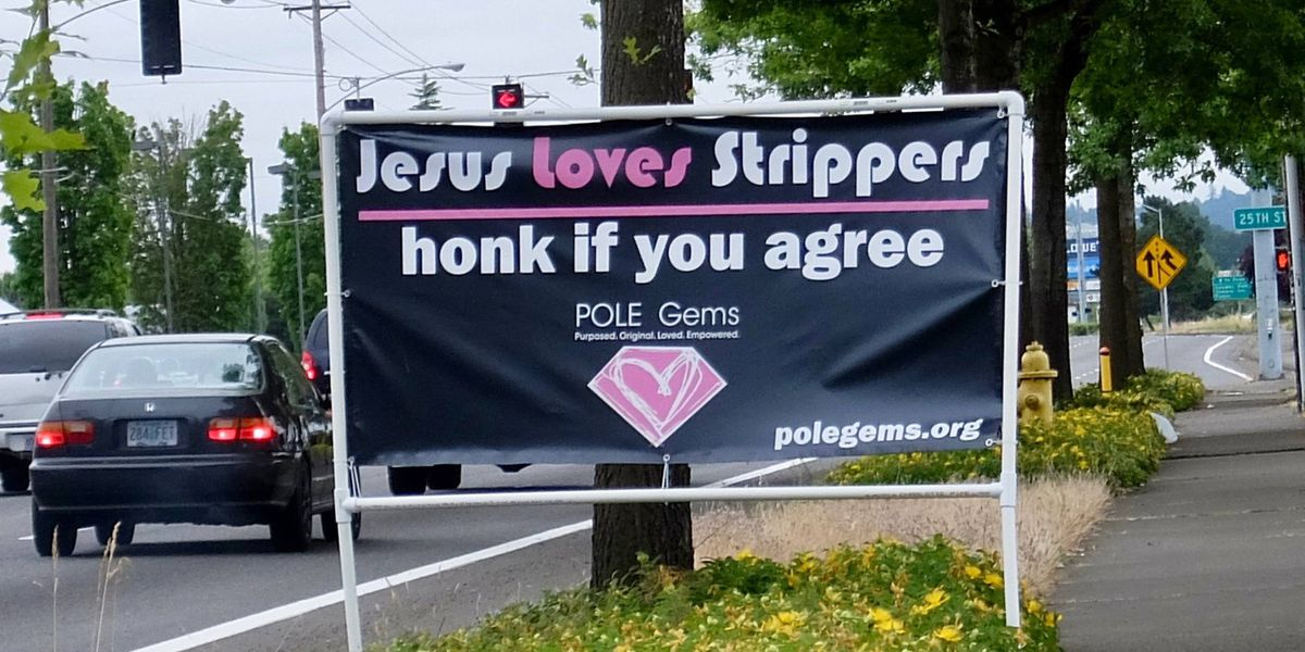 'Jesus loves strippers' sign draws ire for code violation, not text