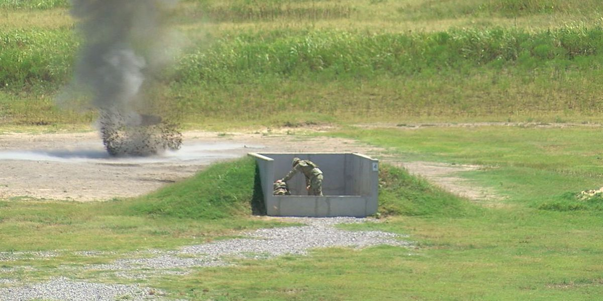 Basic trainees practice throwing at grenade range