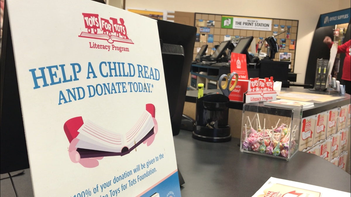 lawton s ups store collects donation for toys for tots literacy program. Black Bedroom Furniture Sets. Home Design Ideas