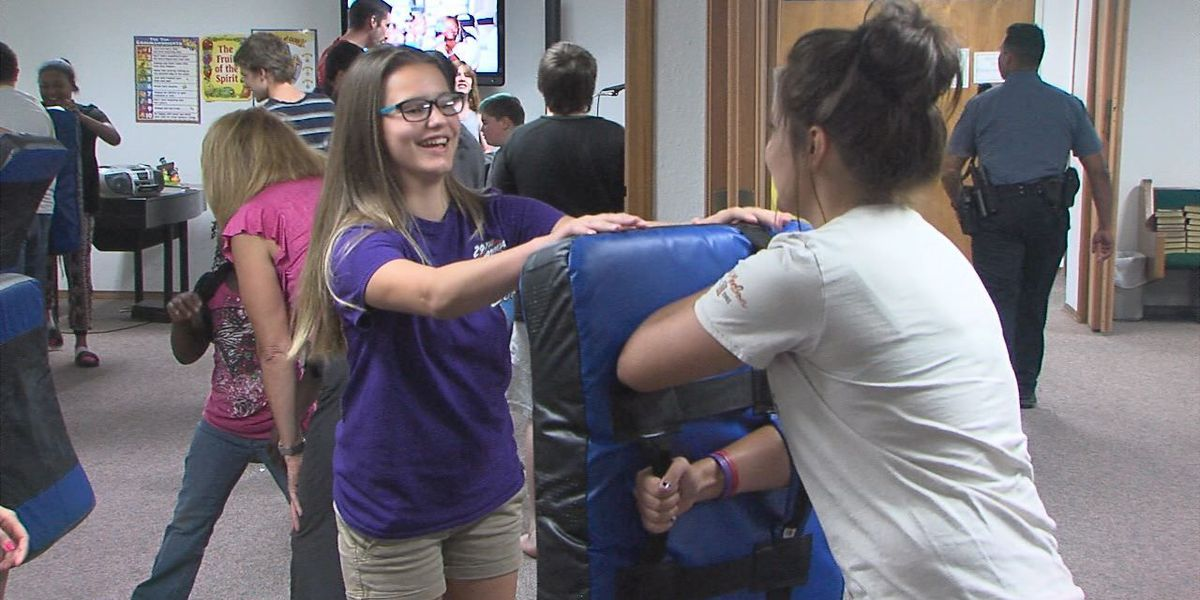 Kids learn defensive tactics at junior police academy