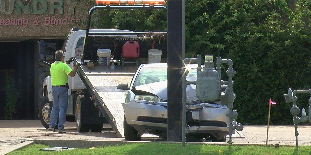 Man arrested after crashing into pole