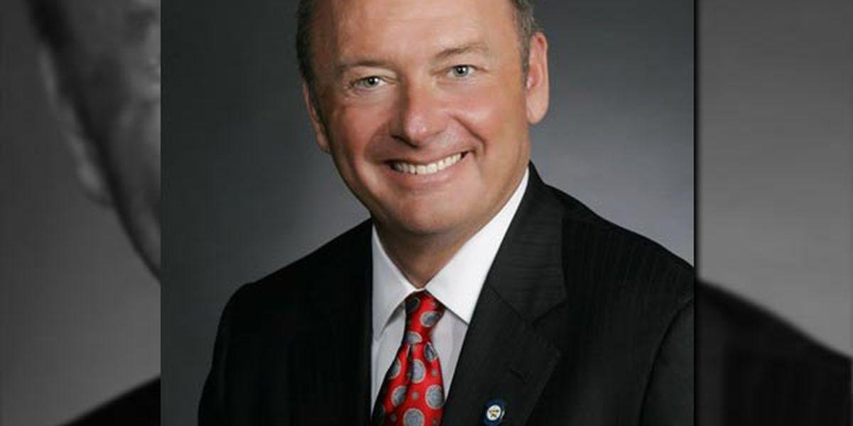 Senator under investigation enters settlement agreement