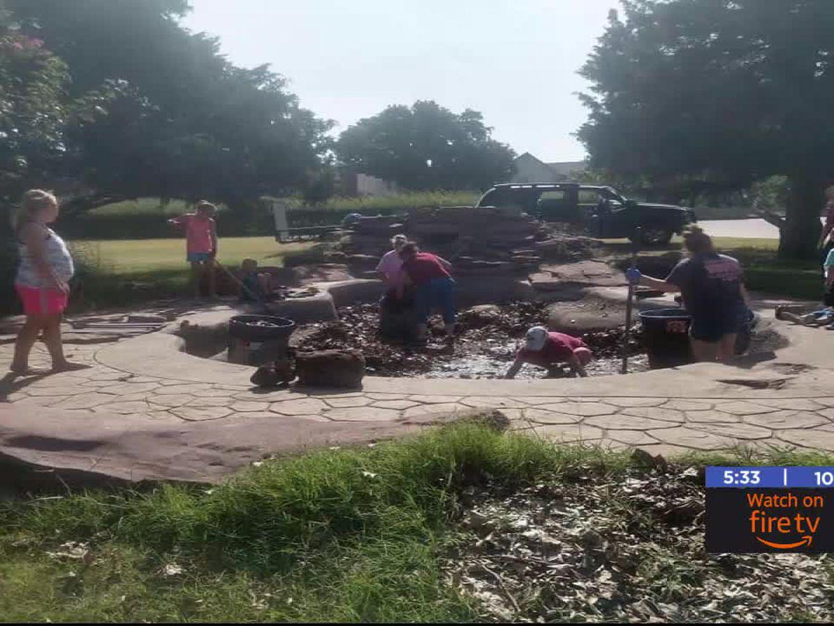 Volunteers clean out pond in Duncan