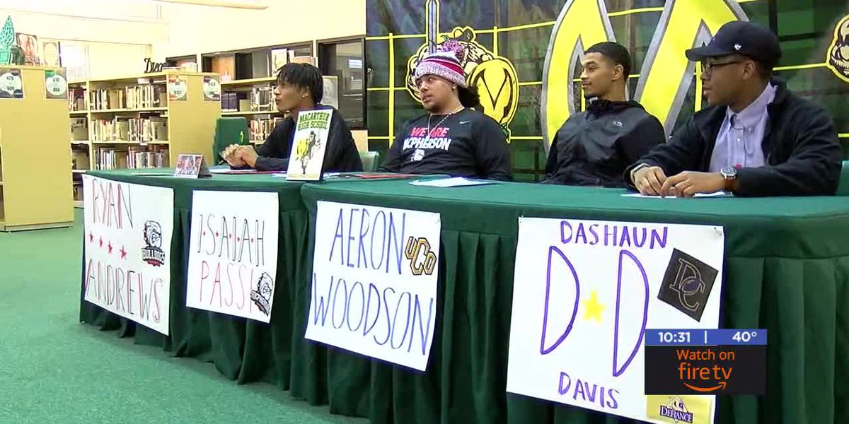 Four Mac football players earn college scholarships