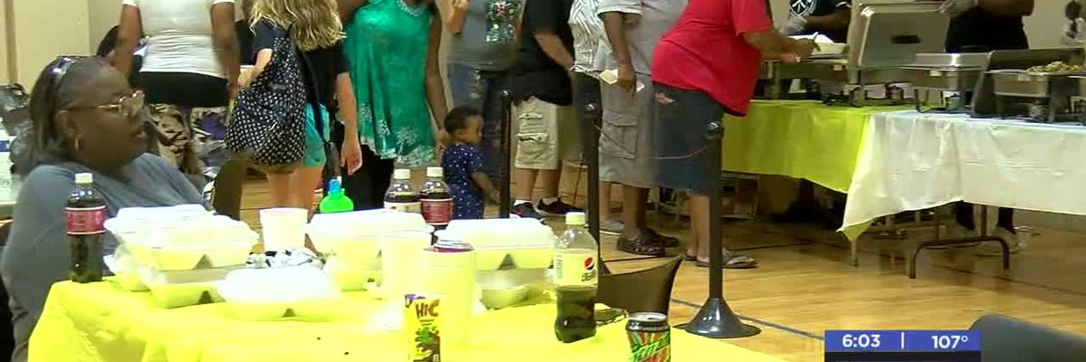 Volunteers serve free meal at Patterson Community Center