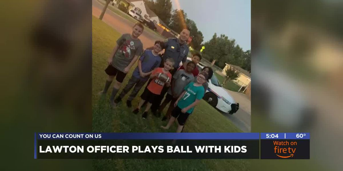 Lawton Police officer plays football with kids