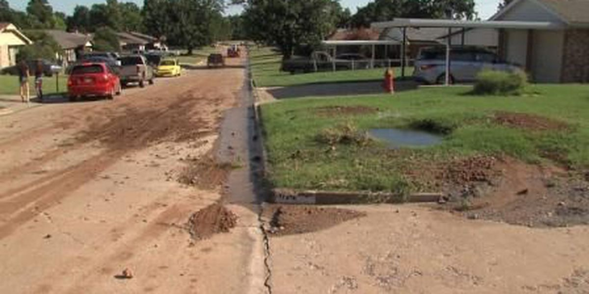 Resident cools off in busted water main