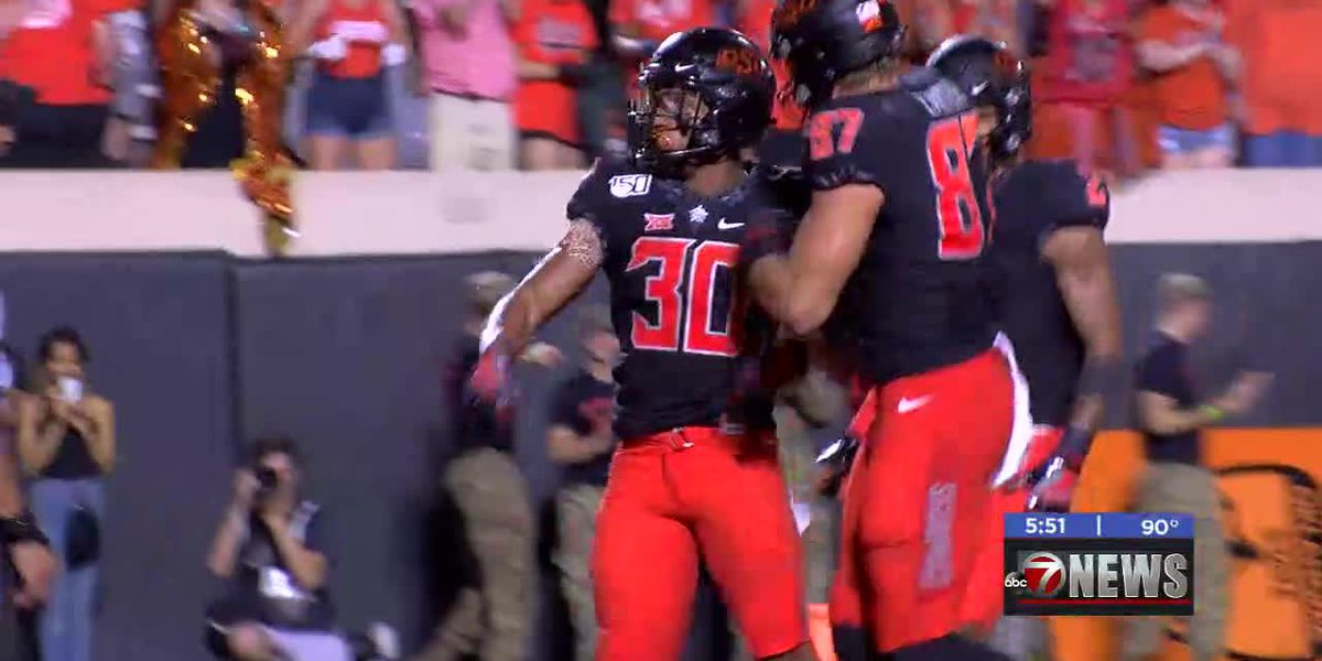Hubbard carries Cowboys to first Big 12 win