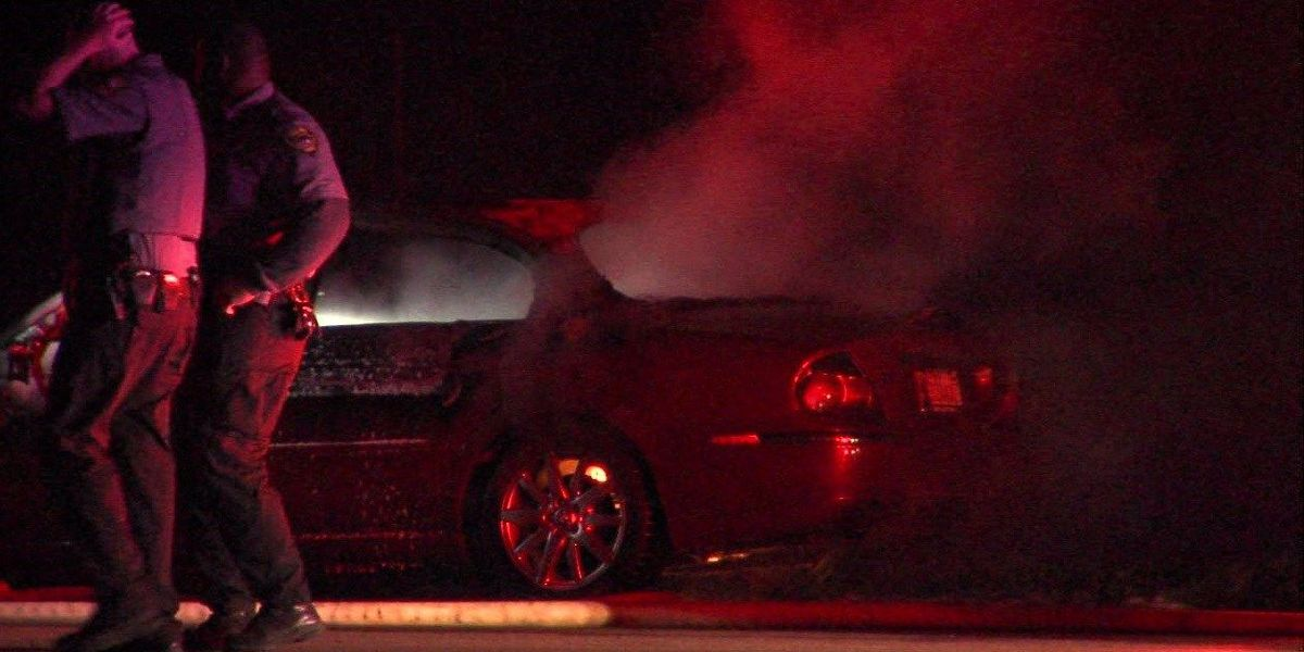 Car found on fire on side of highway