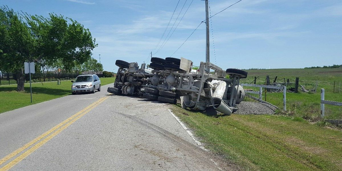 Overturned truck shuts down road to through traffic