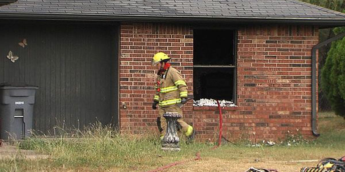 Lawton house fire displaces father, son