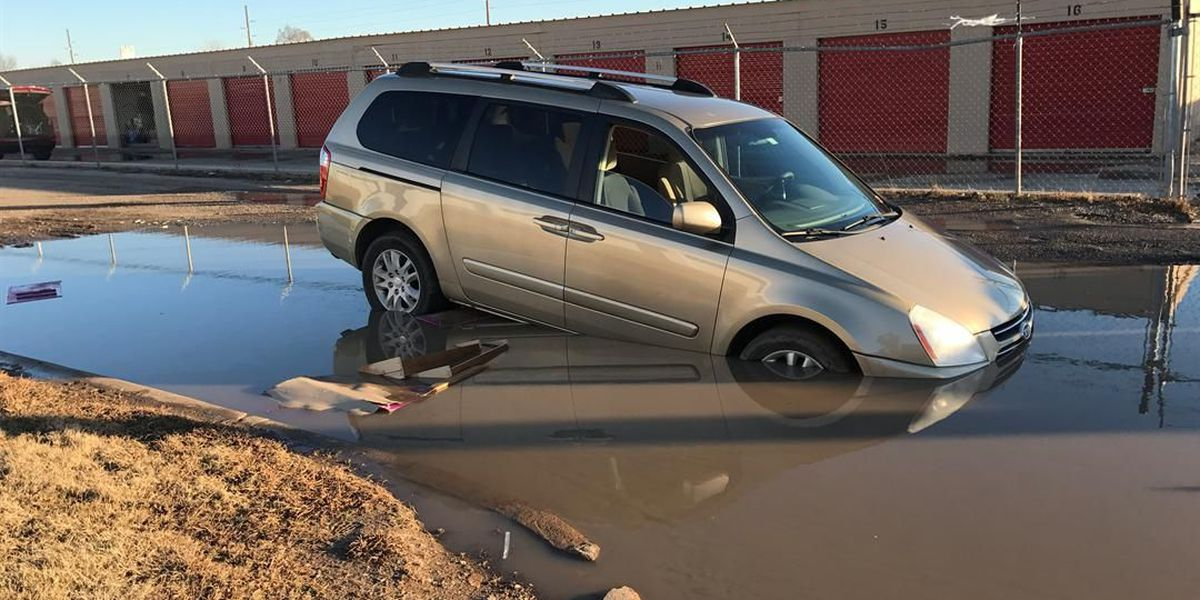 Van gets stuck in water-filled sinkhole